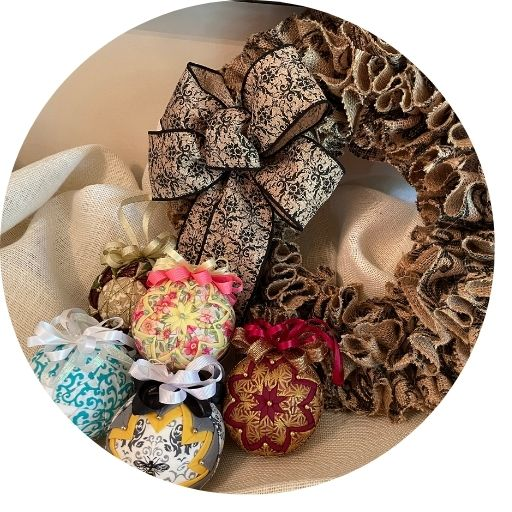 Burlap wreath accented with multi colored ornaments